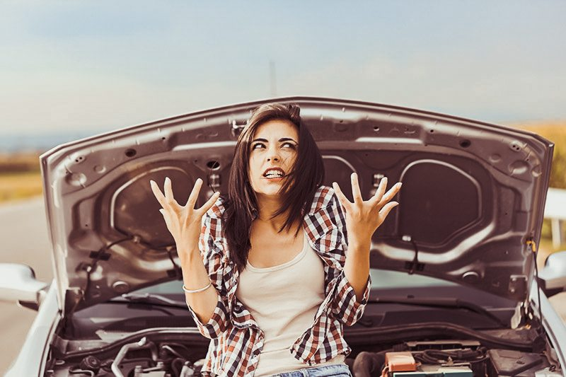 angry woman in front of car